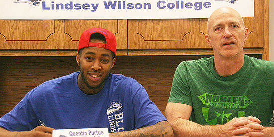 Quentin Purtue (Left) signs with Lindsey Wilson College as a member of the 2014-15 recruiting class.